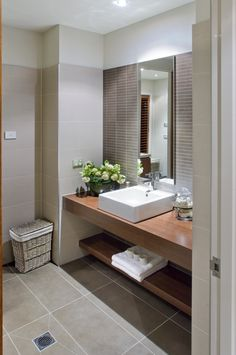 Bathroom Design Idea - wood benches, coffee coloured tile feature wall, complete tiling (designer unknown, Beaumont Tiles) Eyebrow Makeup Tips Laundry In Bathroom, Small Bathroom, Master Bathroom, Bathroom Ideas, White Bathroom, Brown Bathroom Tiles, Bathroom Colours, Basement Bathroom, Bathroom Remodeling