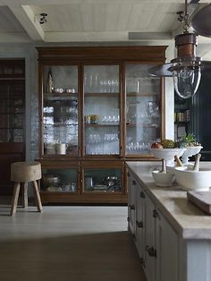 Gorgeous glass breakfront: would look beautiful with rustic galvanized metal as back