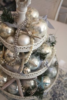 a beachy christmas centerpiece... make tiers from dollar tree stuff, spray paint blue beachy color and fill with mixed match ornaments of same family of color
