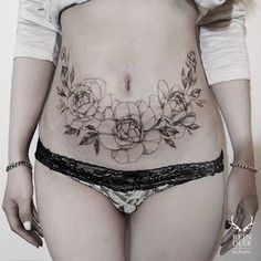 beautiful flower tattoos decorated stomach