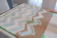 chevron rug DIY - Ikea rug, paint, cardboard stencil.