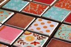 Make your own coasters - 4x4 tiles ($.16 Home Depot); 4x4 scrapbook paper; adhere to tile with Mod Podge and let dry; Spray a coat of clear spray paint and let dry; attach felt pads to the bottom. Great gift idea!