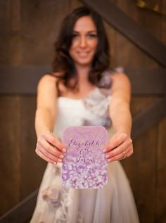 Purple Rustic Wedding - cute picture of the bride with her invitation!