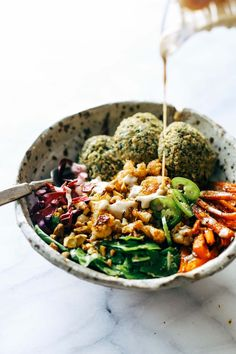 homemade falafel, roasted veggies, and flavorful sauce all in one big bowl! vegetarian / vegan / gluten free