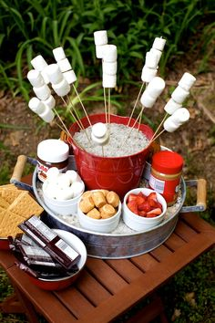 How cute is this s'mores bar over the fire jpit?!