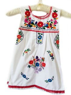 Frida Flower Girl Mexican Handmade Embroidered Baby and toddler Dress. $36.00, via Etsy.