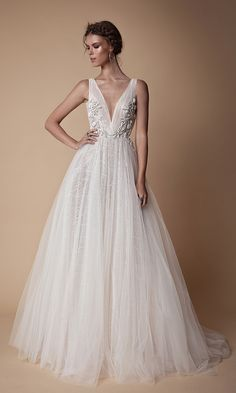 Gorgeous plunging neckline embroidered wedding gown with soft wispy tulle skirt // The second Muse collection from Berta bridal is sexy yet sweet and features sheer fabrics, illusion bodices, intricate lace, wispy tulle, floral embroidery, high slits, skinny straps, plunging necklines, shimmering details, collared bodices, and cold-shoulder sleeves.