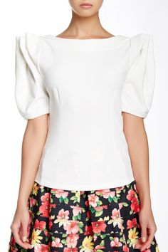 """Ruffle Sleeve Blouse by Gracia Details: - Crew neck - Short ruffled sleeves - Approx. 21"""" length - Imported Fiber Content: 95% polyester, 5% spandex $62.00 This blouse reminds me of Lady Gaga."""