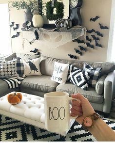 """Give your living room a modern Halloween makeover with a limited color palette. Though the colors are simple, the results will be minimalistic (or """"bare bones"""") chic."""