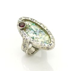 Silver ring with roman glass & a garnet oval shape metalwork ring