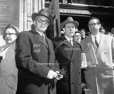 Publisher Bennett Cerf, announcer John Daly and actor Steve Allen, left to right, stand together outside St. Malachy's Church in New York on March 20, 1956 after attending a high requiem mass for Fred Allen. The renowned comedian, who was 61, died of a heart attack late on March 17. (AP Photo/Marty Lederhandler) Fred Allen, Steve Allen, St Malachy, Bennett Cerf, John Daly, Is 61, John Charles, March 20th, Sad Day