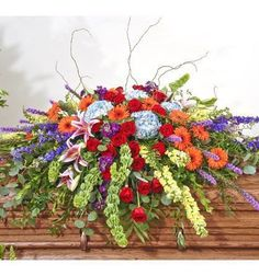 Euro Garden Casket Spray.    A beautiful casket spray of Gerbers, Belles of Ireland, Stargazer Lilies, Hydrangeas, Snapdragons, Stock, Liatris, Larkspur, and Curly Willow
