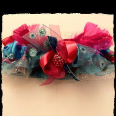 Hot pink and turquoise with feathers and rhinestones prom garter!