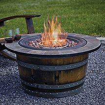 Reclaimed Wine Barrel Fire Pit with Slate Top (http://www.wineenthusiast.com/furniture/wine-furniture/wine-barrel-furniture.asp)