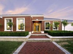 Brick modern house exterior with hedged fence & hedging - House Facade photo 1060214