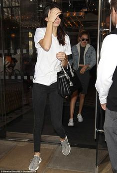 Dressed down: Kendall wore a basic white T-shirt and trainers with a pair of jeans...