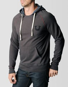#TRholiday13 Cozy mens pullover hoodie highlighted by supremely soft fleece and a serape pattern lining the hood. A horseshoe logo is updated into a scribbly...
