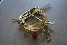 8pc Bangle Bracelet, Gold with Multiple Cross Charms WT, http://www.amazon.com/dp/B0055D2S5C/ref=cm_sw_r_pi_dp_gxOMqb1E8DZGP