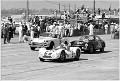 1961 Sebring 12-Hour G.P. Early in the 1961 Sebring race we see the #25 Maserati Tipo 61 of Dave Causey and Luke Stear in close combat with the #12 Ferrari 250 GTSWB of Denise McCluggage and Allen Eager and the #3 Corvette of George Robertson, Ben Burroughs and Bill Warren.  The Vette and the Maserati Tipo would fail to finish while the Ferrari would come in 10th and first in class.  The photo by George Phillips shows the cars passing the pits and on their way to...