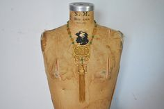 LARGE Buddha Necklace / 1970s pendant with tassel by badbabyvintage on Etsy