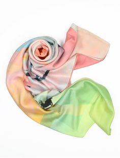 Beautiful pastels of green, pink, and yellow in this Lily wrap! Wear it as a scarf, a headband or a bag!