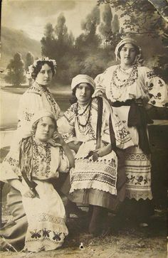 I have a framed apron that my great-grandmother made and which looks just like the aprons these women are wearing.  So cool!  (1914 Antique Russian Photograph Ukrainian Folk Dress)