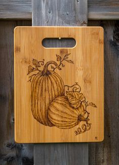 Gift for her! This is a beautiful Pumpkin freehand pyrography art, custom design that is burned onto 8-1/2 x 11 (21.5 x 28 cm) on high-quality real bamboo cutting board and mineral-oiled to be food safe! Board thickness is 3/8 (1 cm).  This custom art-crafted board makes a perfect Thanksgiving, Halloween, Housewarming, Holidays, Christmas, Wedding, Anniversary or Birthday present! This unique, one-of-a-kind gift has a warm and personal feel that will touch the special person in your...