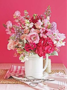 Cut an inch off the stems using a sharp knife, especially if the flowers will sit a while before being arranged. The fresh cut will help the stems absorb water better.