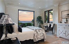 Very chic black and white color palette in this ocean view bedroom.