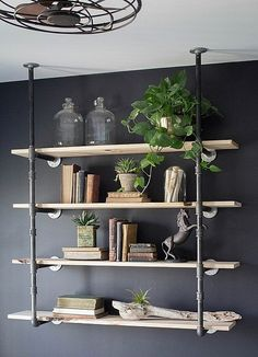 Give old pipes a whole new look by incorporating them in a rustic shelf space.