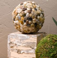 GARDEN BALLS: Pebble Spheres Richly textured mosaic spheres reminiscent of a walk on the beach are the perfect complement to softer, greenery-inspired home accents. Explore the combinations! Outdoor Crafts, Outdoor Projects, Garden Crafts, Garden Projects, Garden Ideas, Bowling Ball Art, Bowling Ball Crafts, Garden Balls, Garden Spheres