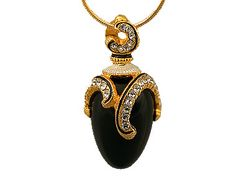This is a very nice Faberge style pendant with an interesting drape motif. It is made of onyx, Austrian crystals and black opaque enamel. This egg is made of sterling silver and then finished with a 18kt yellow gold overlay. It was delicately crafted by Russian jewelers through elaborate and laborious efforts.