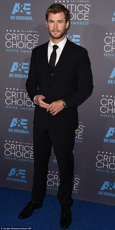 Back in black: Chris Hemsworth looked suave in a black three-piece suit as he attended the Critics Choice Awards in Hollywood on Thursday night Chris Hemsworth Thor, Black Three Piece Suit, Snowwhite And The Huntsman, Hemsworth Brothers, Fancy Suit, Marvel Actors, Sharp Dressed Man, Black Suits, Men's Clothing