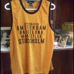 ‼️ FINAL PRICE ‼️ Orange/rust colored tank with black trim.  Never worn Forever 21 Tops Tank Tops