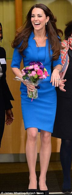 The Duchess was greeted by raucous applause by the school's 1,000 pupils when she arrived in the school hall
