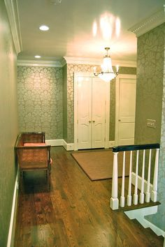 Katherine Connell Interior Design upstairs #hallway with Osborne and Little wallpaper