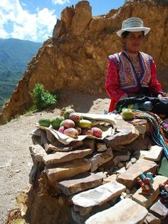 Photo: Peruvian selling wares on the high cliffs of Colca Canyon, Peru