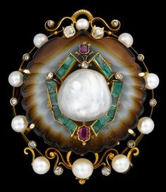 18 karat yellow gold natural pearl and gem set 'shell' brooch   Georgian   Carved sardonyx 'shell' displays single natural saltwater pearl, surrounded by caliber cut emeralds and accented by petite pinch set rubies, pearl and diamond frame surround.