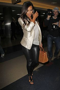 Kim Kardashian Photo - Kim Kardashian shows off all of her assets in tight leather leggings and a white jacket, as she catches a flight out of LAX in Los Angeles