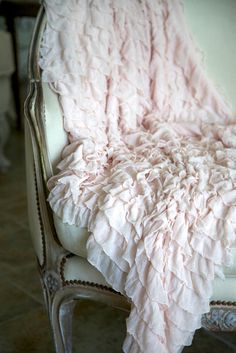 Blush Pink Ruffled Throw for tossing over your sofa, bed or chair....or to drape over a table for that shabby romantic look. Measures approximately 46 by 38 with 2 ruffles all over and of a nylon poly blend.