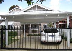Carport With Storage Door To Kitchen And Storage On Sides