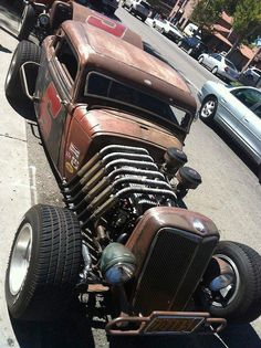 Rat Rod, I like the use of the 6 cylinder with neat wrap-over pipes on this one, not like all the other V-8 rides,..just a little more unique.