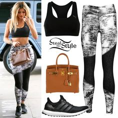 Kylie Jenner was spotted arriving at Topanga Mall today wearing an Essential Running Bra ($17.39+) and Wtclash Long Tights ($34.99) both by Puma, the Hermès Birkin 30 Gold Togo Bag (Not available online) and a pair of Adidas Ultra Boost Shoes ($180.00).