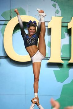 Cheer Athletics, stunt, competition, competitive cheerleading, extention, heel stretch m.15.82 moved from @Kythoni Cheerleading: Competitive board http://pinterest.com/kythoni/cheerleading-competitive/ p.1.1 #KyFun
