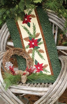 """Granola Girls Designs Nature's Table Toppers - """"Poinsettia"""". Pin to Quilted Table Toppers.  Poinsettia applique templates and patterns added to a simple quilted table topper. Find it online: http://landauerpub.com/Granola-Girl-Designs-Table-Toppers-Celebrating-the-Great-Outdoors.html"""