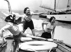 A group of unknown women on a speedboat. Photographed by Norman Parkinson (1913-1990), c. 1937.