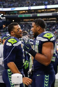 Bobby Wagner of the Seattle Seahawks celebrates with Russell Wilson after an interception return for a touchdown in the fourth quarter against the San Francisco at CenturyLink Field on December. Get premium, high resolution news photos at Getty Images Seahawks Fans, Seahawks Football, Football Fans, Seattle Seahawks, Football Players, College Football, Nfc Teams, Doug Baldwin, Bobby Wagner