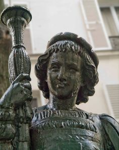 Detail of the cast iron statue made by Fonderies d'Art du Val d'Osne : Young Page by Mathurin Moreau, seen in Paris 14th district