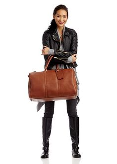 A larger version of the best selling Cassidy weekender in soft vegan leather with gold-toned hardware and metal feet on the bottom......84.95  i have to get this bag!