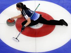 Vicki Adams of Scotland throws the stone in the match between Japan and Scotland during Day 3 of the Titlis Glacier Mountain World Women's Curling Championship at the Volvo Sports Centre in Riga Latvia. Curling Canada, Tennis Accessories, Clothing Accessories, Women's Curling, Tennis Trainer, Women's Hockey, Evolution T Shirt, Olympic Sports, Cute Posts